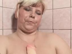 Lush towheaded is having a bathroom and practising her titfucking routine with her favourite fake penis