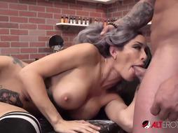 Good looking honey with monstrous, rock hard bra-stuffers, Vanessa Skye is providing a deep throat to a tat artist