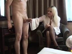 Expert, mature dame is softly kneading her counterpart's prick knowing what he luvs the most