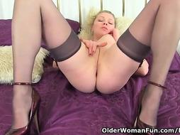 English female with massive bod, Abi is dressed in dark-hued pantyhose and garter belt while wanking