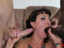 Inked girl who enjoys DOUBLE PENETRATION, Dollie Darko is groaning during an multiracial three-way with her boys