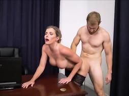 Cory Pursue is dressed in nothing but dark-hued tights while getting a rear poke in her office