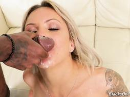Nina Elle is anxiously deep-throating a gigantic, dark-hued meat stick, while getting doublefucked at the same time