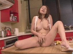 Molten and fantastic sandy-haired toying with a stiff banana in the kitchen