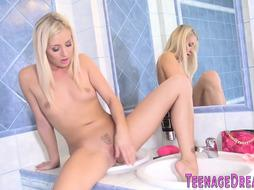 First-Timer showering teenager with smallish globes