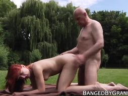 Red-Haired stunner with all-natural bumpers smashes elder fellow outdoor