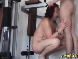 Crimson haired damsel with pierced nips is throating beef whistle in the gym before getting boinked stiff