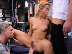 Virgin Smooch is having hard-core bang-out in the gym, with 2 studs at the same time