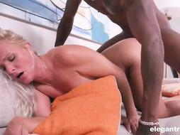 Naughty, blond cougar is throating a rock firm, dark-hued prick and getting it up her backside