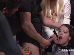 Brunette slave gets facials in public