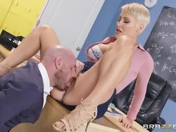 Busty blonde lady likes to have sex in the classroom