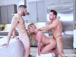 Blonde milf is rubbing her handsome lover's dick while another one is drilling her hairy pussy