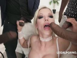 Busty blonde woman is satisfying many black guys at the same time and enjoying it a lot