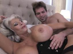 Sally D'angelo is a big titted, blonde woman who likes to get fucked by younger guys