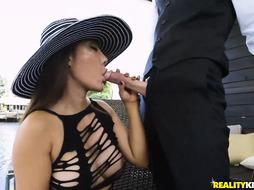 Big tited Asian girl is down on her knees and drooling on a stranger's throbbing cock
