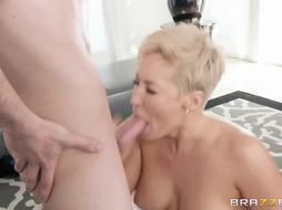 Brief haired blond, Ryan Keely is having casual fucky-fucky with Jordi in her living apartment