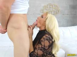Blonde MILF is giving a hot blowjob to her stepson