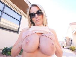 Blonde woman likes to show her milk jugs in public places