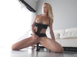 Slim blonde lady is masturbating