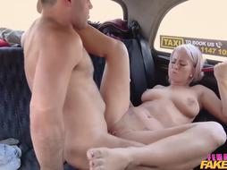 Nice blonde girl is fucking in a fake taxi