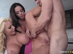 Blonde woman and her friend are having a threesome