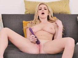 Georigie is squeezing her tits while stimulating her pussy