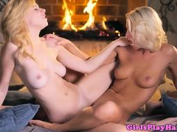 Stylish blond dykes tribbing at fireplace
