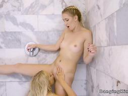 Light-Haired all girl bffs scissoring in the bathroom