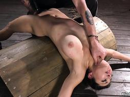 Busty hairy brunette fingered in hogtie