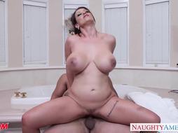 Nasty mummy Eva Notty gives boob fucking