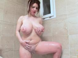 Gigantic jugged vixen is not only frolicking with her milk baps, she is also using a fuck stick