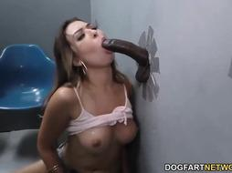 Trampy honey, Melissa Moore is gargling a gigantic, dark-hued pecker thru a gloryhole and railing it
