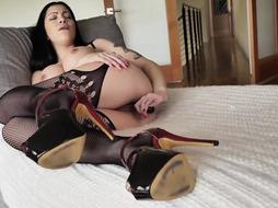 Smoking sizzling black-haired in ebony tights, Cassandra Cain luvs to have fun with a glass faux-cock, every day