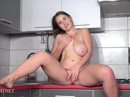 Plump dark haired coed, Alesya Romero is toying with her melons and labia, in the kitchen