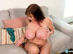 Big-Titted mature chick, Shelby Gibson enjoys to have fun with her giant orbs and smooth-shaven cunt