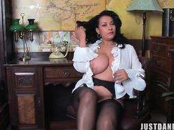 Elegant plump black-haired cougar with enormous knockers is toying with her puss while alone at home