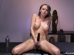 Big tits oiled brunette fucking machine